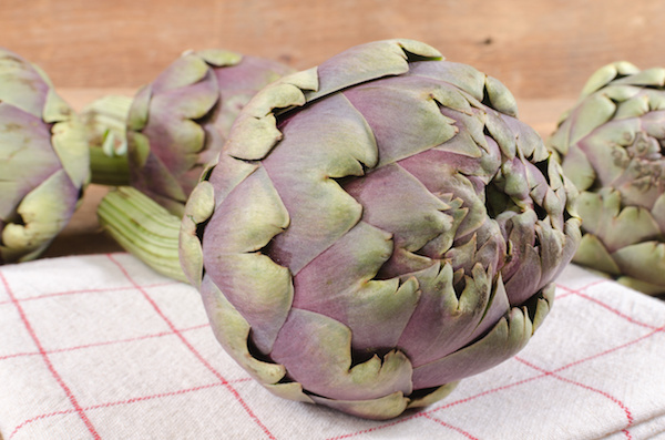 Fresh artichokes on wooden background