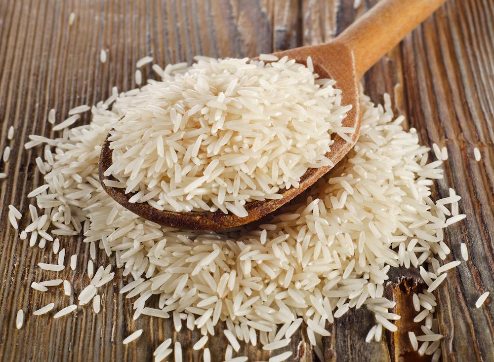 Raw basmati rice in  wooden  spoon