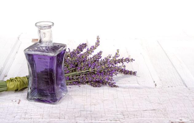 14667440 - lavender spa still life with bottle of lavendar infused oil on a vintage door